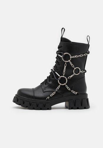 CYRUS - Šněrovací kotníkové boty - black