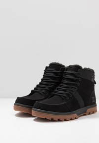 DC Shoes - WOODLAND - Korkeavartiset tennarit - black - 2