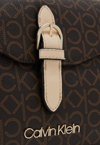 Calvin Klein - FLAP CROSSBODY - Across body bag - brown - 3