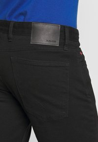 s.Oliver - Slim fit jeans - black denim - 5