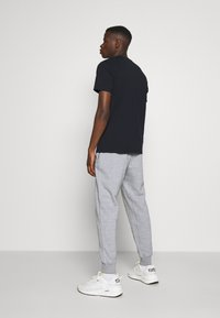Nike Sportswear - JOGGER  - Teplákové kalhoty - multi/obsidian - 2