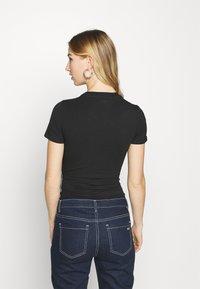 Tommy Jeans - SHORTSLEEVE TAPE - Print T-shirt - black - 2