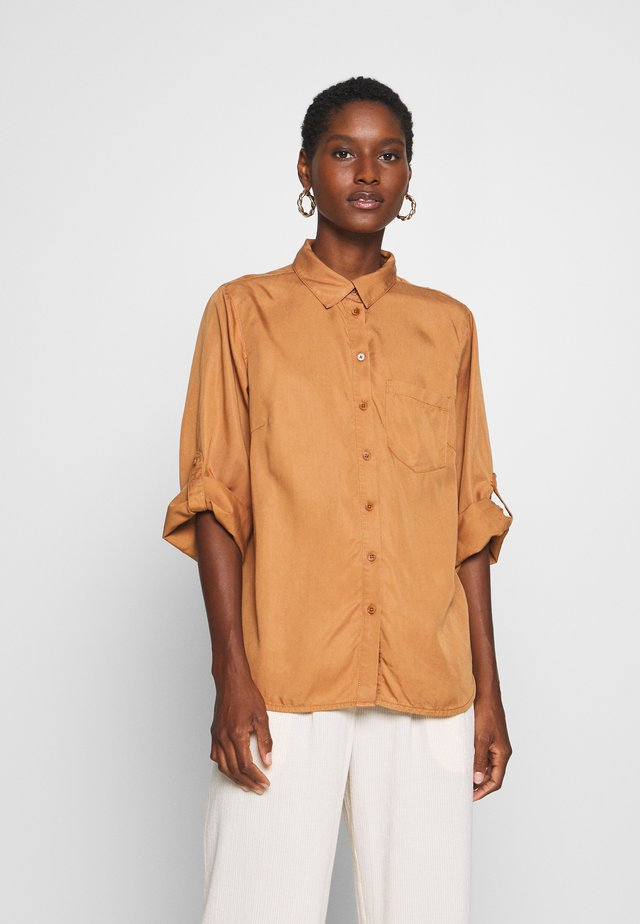 CINDIE - Button-down blouse - lion