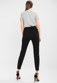 Vero Moda - VMEVA LOOSE STRING PANTS - Broek - black - 2