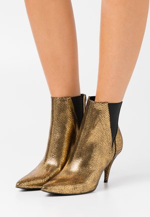 RASHEL - High heeled ankle boots - bronzo