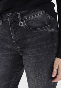 PULZ - PZLIVA  - Flared Jeans - black denim - 4