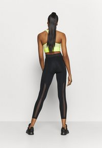 Nike Performance - 7/8 FEMME - Tights - black - 2