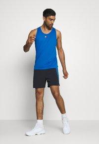 Tommy Hilfiger - TRAINING TANK LOGO - Sports shirt - blue - 1