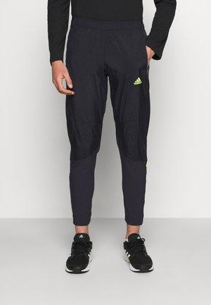 ULTRA PANT - Teplákové kalhoty - black/yellow