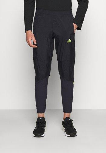 ULTRA PANT - Pantaloni sportivi - black/yellow