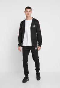 Kings Will Dream - DEFLOUR JOGGERS WITH TAPING - Tracksuit bottoms - black - 1