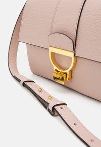 Coccinelle - ARLETTIS CROSSBODY - Across body bag - new pink - 3