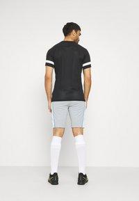 Nike Performance - DRY SHORT - Sports shorts - light pumice/white - 2