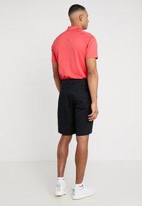 Nike Golf - FLEX SHORT ESSENTIAL - Pantalón corto de deporte - black - 2