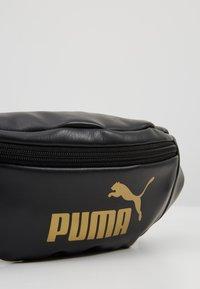 Puma - CORE UP WAISTBAG - Riñonera - black/gold - 6