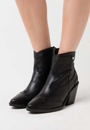 BRAMI - Ankle boots - black