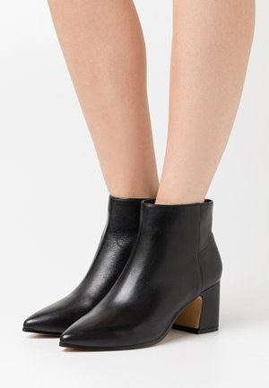 KISSA - Ankle boots - black