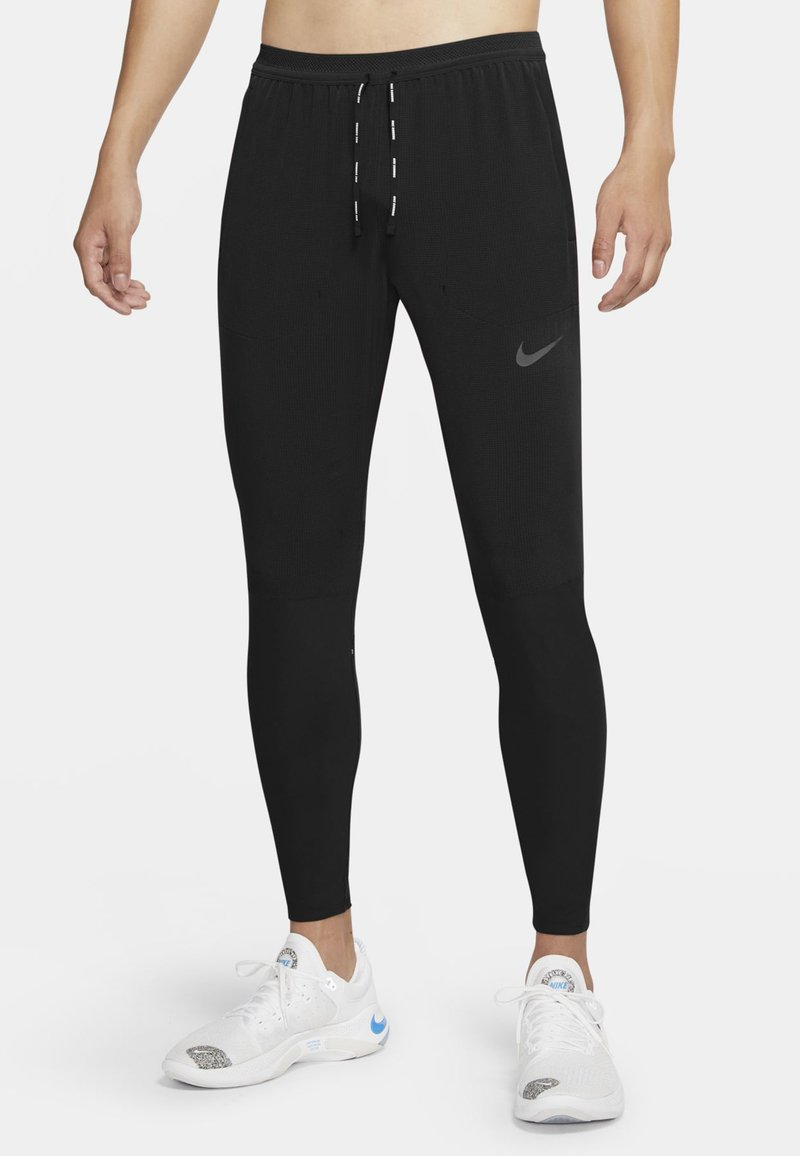 Nike Performance - SWIFT PANT - Tracksuit bottoms - black/black/blkref