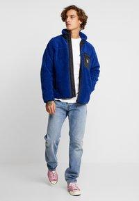 Carhartt WIP - KLONDIKE MILLS - Straight leg jeans - blue worn bleached - 1
