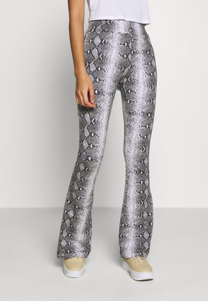 SIGNATURE SNAKE FLARED PANTS - Trousers - black/white/red