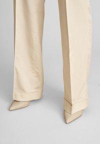 ECHTE - Trousers - pale peach - 3