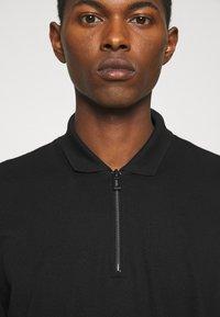 HUGO - DONHAM - Polo shirt - black - 3