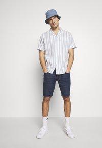 Levi's® - 511™ SLIM  - Shorts vaqueros - rye short - 1