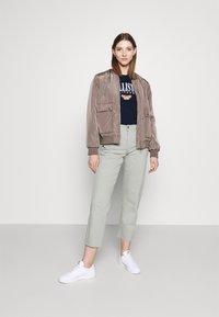 Hollister Co. - TECH CORE - Print T-shirt - navy blazer - 1