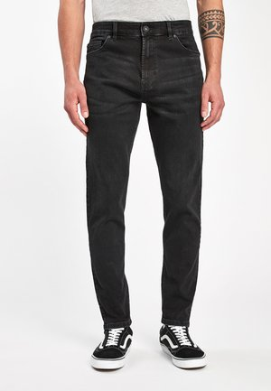 WITH STRETCH - Jeans Tapered Fit - black
