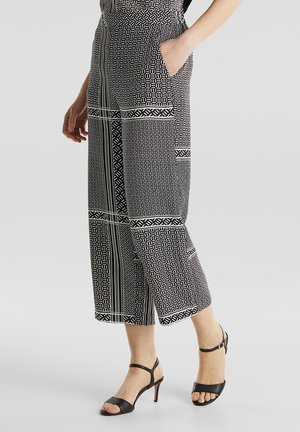 ALLOVER PRINTED PANTS - Trousers - black