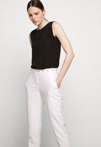 HUGO - HAZENA - Trousers - natural - 3