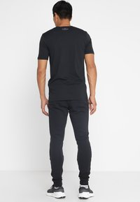 Under Armour - RIVAL  JOGGER - Tracksuit bottoms - black - 2