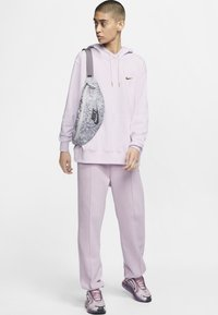 Nike Sportswear - PANT  - Tracksuit bottoms - iced lilac - 1