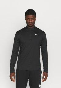 Nike Performance - T-shirt à manches longues - black/silver - 0