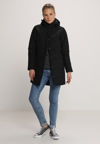 Jack Wolfskin - SVALBARD COAT WOMEN - Winter coat - black - 1