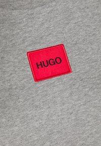 HUGO - NEYLETE REDLABEL - Sukienka z dżerseju - grey melange - 5