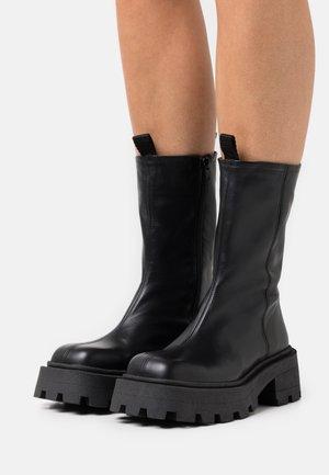 BIADESSIE ZIP BOOT - Platform ankle boots - black