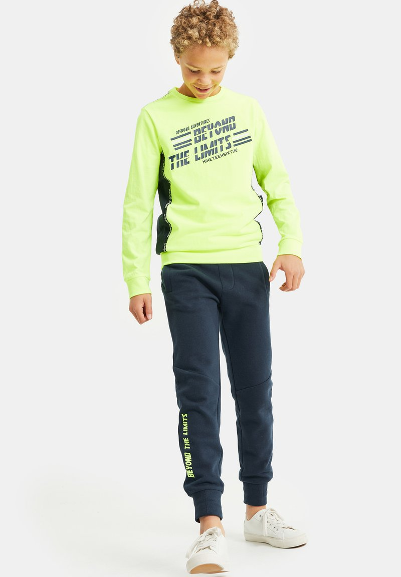 WE Fashion - MET OPDRUK EN TAPEDETAIL - Long sleeved top - neon yellow
