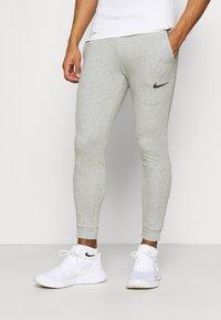 Nike Performance - PANT TAPER - Tracksuit bottoms - dark grey heather/black - 0