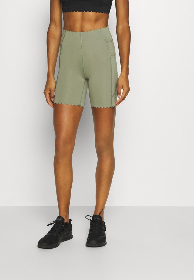SCALLOP HEM BIKE - Leggings - basil green