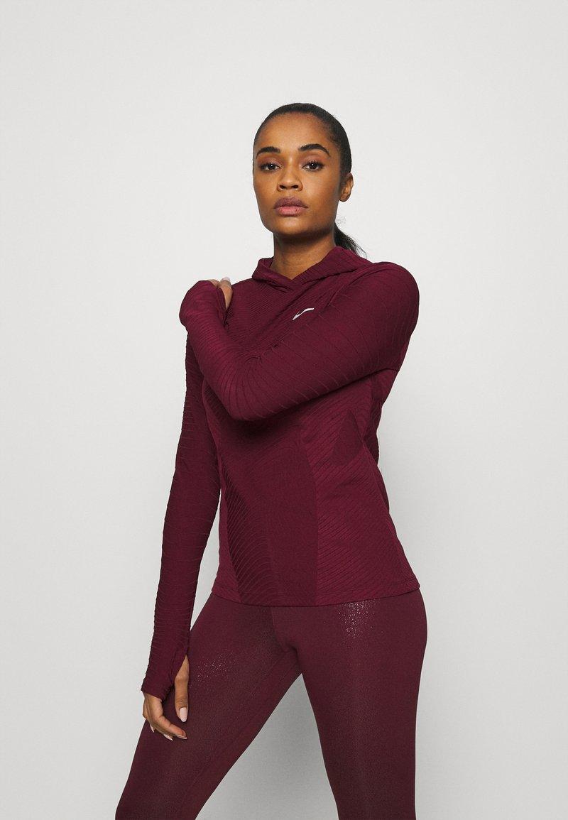 Nike Performance - HOODIE RUNWAY - Sports shirt - dark beetroot