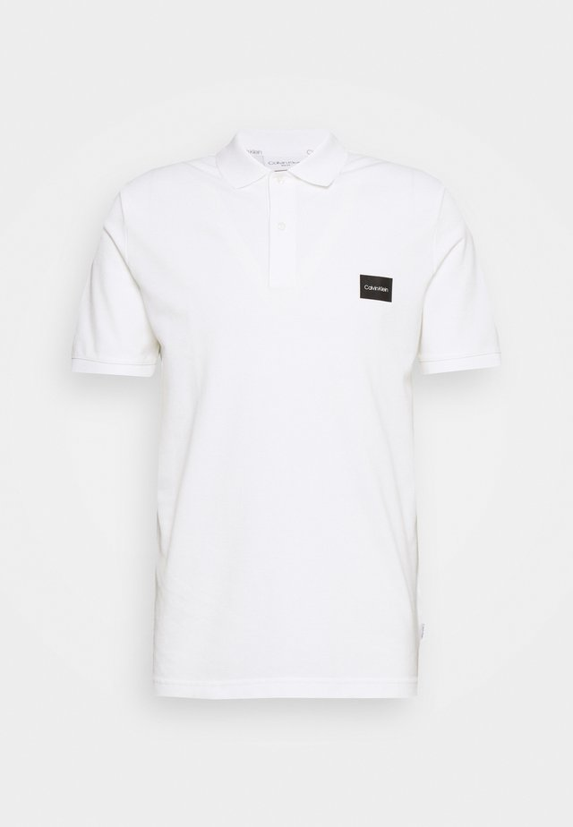 BADGE SLIM - Polo shirt - white