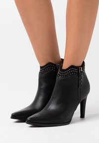 XTI - High heeled ankle boots - black - 0