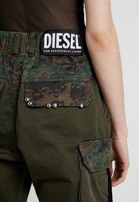 Diesel - THENA TROUSERS - Trousers - olive - 5