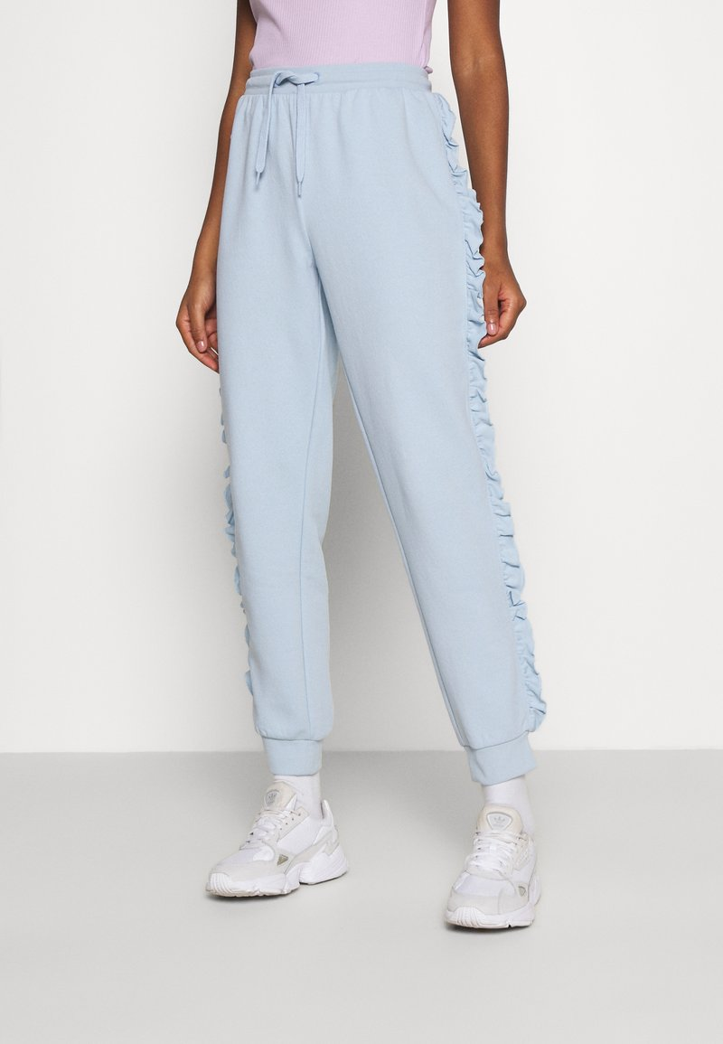 ONLY - ONLAVA FRILL  - Tracksuit bottoms - blue