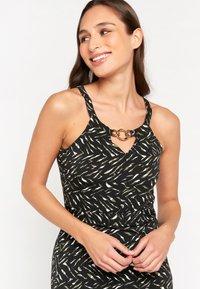LolaLiza - WITH PRINT AND HALTER-NECK - Maxi dress - khaki - 2