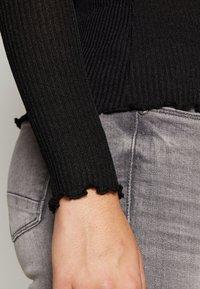 Vero Moda Tall - VMOPHELIA HIGHNECK FRILL - Pullover - black - 6
