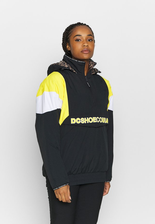 TRANSITION WMNS REVERSIBLE ANORAK - Snowboardjas - black
