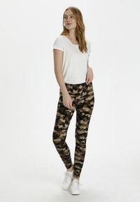 Culture - CUSEMIRA  - Leggings - Trousers - brown camouflage - 1