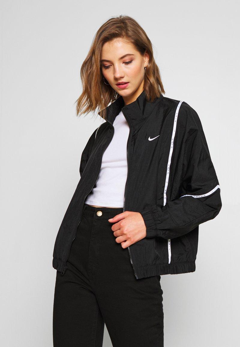 Nike Sportswear - PIPING - Leichte Jacke - black/white